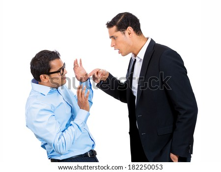 Closeup portrait of rude, mad, giant business man threatening, pointing at his nerdy guy coworker, isolated on white background. Negative emotion facial expression feelings. Office conflict resolution - stock photo