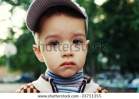 Closeup portrait of sad boy - stock photo
