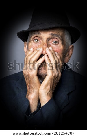 Closeup portrait of sad old man isolated over gray background - stock photo