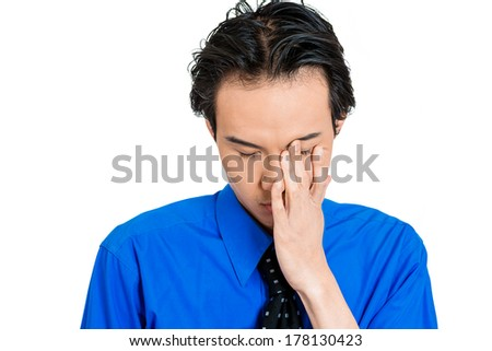 Closeup portrait of sad, upset, depressed young business man, student, employee worker, hand on face, totally defeated isolated on white background. Negative human emotions, face expressions, reaction. - stock photo