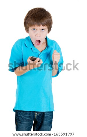Closeup portrait of screaming, angry, young kid on the mobile phone, isolated on white background. Negative human emotions and facial expressions. Communication, conflict resolution - stock photo