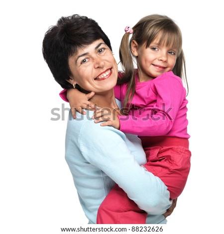 Closeup portrait of senior Caucasian woman with little granddaughter - stock photo