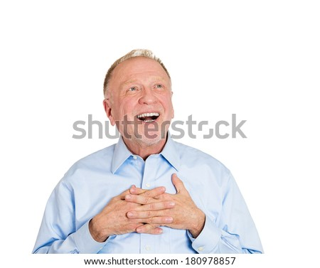 Closeup portrait of senior elderly mature man with smile on face, in love looking up, hands on chest thinking, good memories of past, daydreaming isolated white background. Human emotions, expressions - stock photo