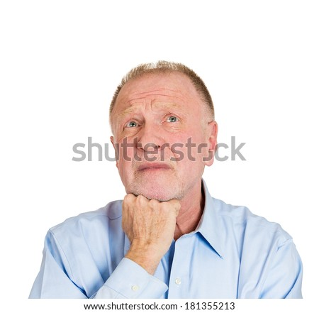 Closeup portrait of senior mature depressed man really sad, deep in thought, realizing truth, chin on hand, looking up, isolated on white background. Human face expression emotion feeling, reaction - stock photo