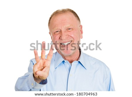 Closeup portrait of senior mature man giving a three fingers sign gesture with hands, isolated on white background. Positive emotion facial expression feeling,symbols - stock photo