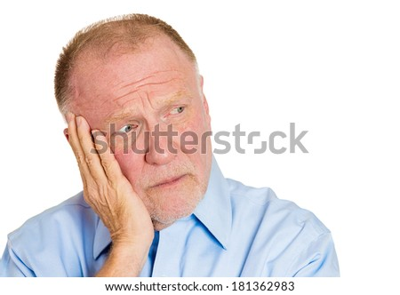 Closeup portrait of senior mature, unhappy man, pissed off by something that worries him, looking to side, hand on cheek, isolated on white background. Negative human emotions. Face expressions. - stock photo