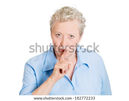 Closeup portrait of senior mature woman placing finger hand on lips, shhh gesture, quiet, silence , isolated on white background. Negative facial expression, sign, emotion, feelings, body language - stock photo
