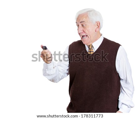 Closeup portrait of senior, old business man shocked surprised, opened mouth, eyes, by what he sees on his cell phone, isolated on white background. Human emotion, facial expression, feeling, reaction - stock photo