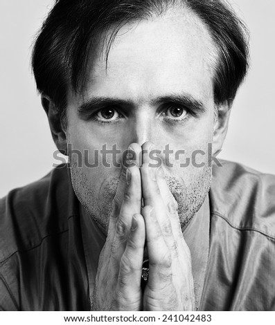 Closeup portrait of sensual man with nice face and eyes,detailed portrait of young good looking male model in grey background, Sad young man, man portrait close up, model male, man in 35 years - stock photo