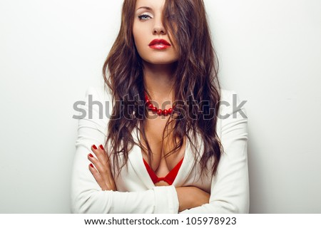 closeup portrait of sexual woman over white wall - stock photo