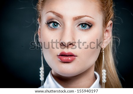 Closeup portrait of sexy blonde girl with blue eyes - stock photo