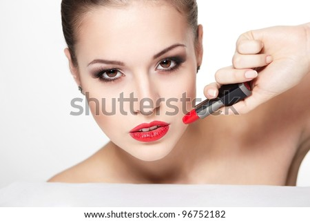 closeup portrait of sexy caucasian young woman model with glamour red lips,bright makeup, eye arrow makeup, purity complexion with red lipstick. Perfect clean skin - stock photo