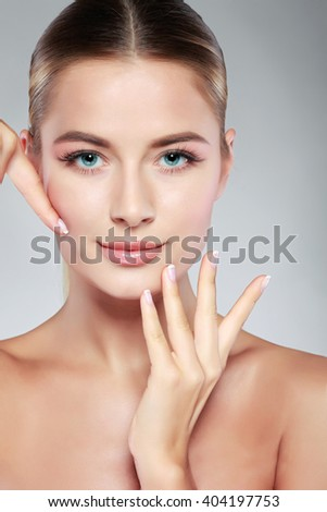 Closeup portrait of sexy whiteheaded young woman with beautiful blue eyes isolated on a light - grey background, emotions, cosmetics - stock photo