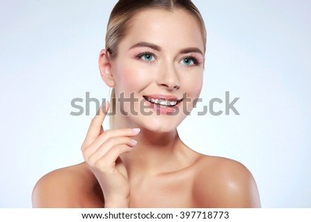 Closeup portrait of sexy whiteheaded young woman with beautiful blue eyes isolated on a light-grey background, emotions, cosmetics - stock photo