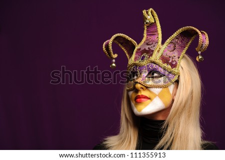 closeup portrait of sexy woman in violet party mask - stock photo
