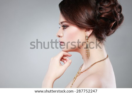 Closeup portrait of sexy  young woman with beautiful green eyes on  a light - grey background - stock photo