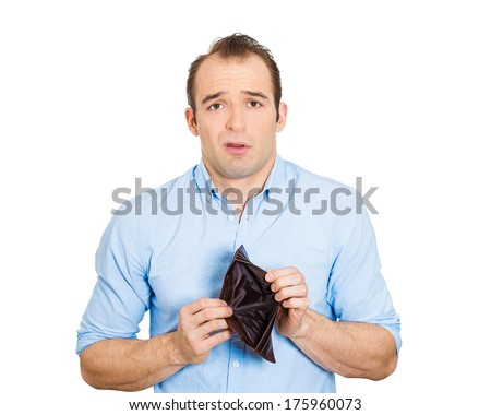 Closeup portrait of shocked puzzled sad unhappy business man worker employee, funny looking guy, student holding empty wallet isolated on white background. Bankruptcy financial difficulty. Expressions - stock photo