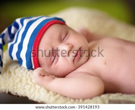 closeup portrait of sleeping newborn baby - stock photo