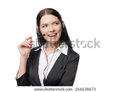 Closeup portrait of smiling attractive woman with headphone looking away at blank copy space, isolated against white background - stock photo