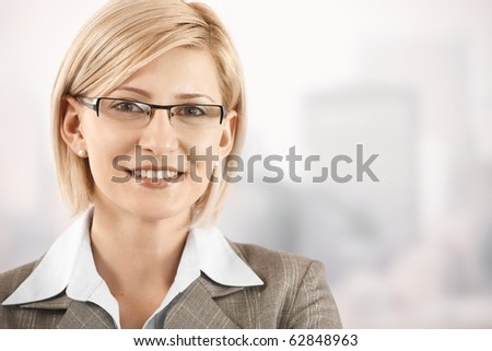 Closeup portrait of smiling blonde businesswoman wearing glasses.? - stock photo