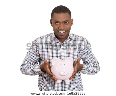 Closeup portrait of smiling man, student, young guy, worker holding piggy bank, happy about his savings, isolated on white background. Smart financial investment decisions. Budget management, control  - stock photo
