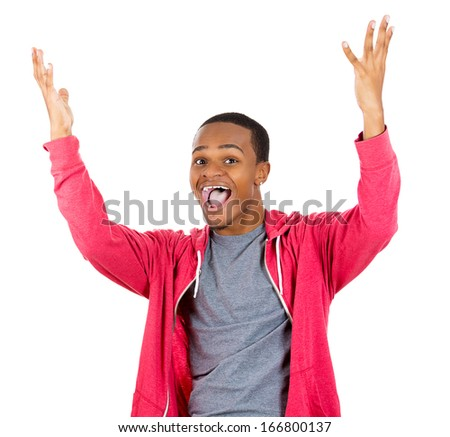 Closeup portrait of super happy excited smiling young man in red hoody with hands up in air, isolated on white background. Positive emotion facial expression feeling - stock photo