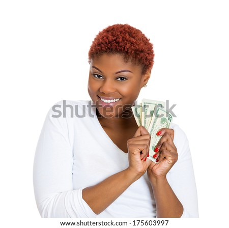 Closeup portrait of super happy excited successful young business woman holding money dollar bills in hand, isolated on white background. Positive emotion facial expression feeling. Financial reward  - stock photo