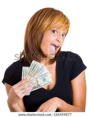 Closeup portrait of super happy excited successful young woman holding money dollar bills in hand, isolated on white background. Positive emotion facial expression feeling. Financial reward savings - stock photo