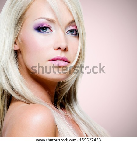 Closeup portrait of the beautiful blond woman with pink makeup - stock photo