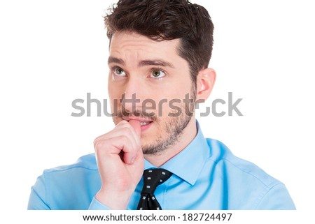 Closeup portrait of thinking man with finger in mouth, sucking thumb, biting fingernail in anxiety, stress, deep in thought, isolated on white background. Negative emotion, facial expression, feelings - stock photo