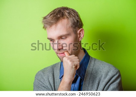 Closeup portrait of thinking man with finger in mouth, sucking thumb, biting fingernail in anxiety, stress, deep in thought. Negative emotion, facial expression, feelings - stock photo