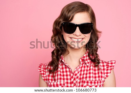 Closeup portrait of trendy young girl in black goggles - stock photo