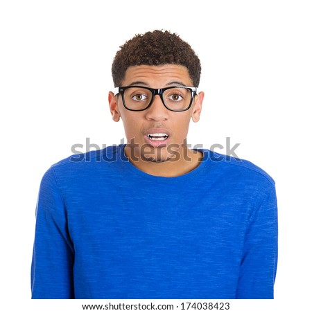 Closeup portrait of truly stunned nerd young man open mouth jaw drop, in blue shirt and big glasses, isolated on white background. Negative human emotion facial expression feelings - stock photo