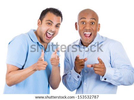 Closeup portrait of two cool guys pointing fingers at you gesture and smiling, isolated on white background - stock photo