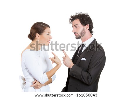 Closeup portrait of two people, man and woman, husband accusing wife in wrong doing, pointing finger at her, she is in denial, blaming each other for the problem, isolated on white background. Concept - stock photo