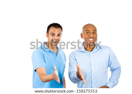 Closeup portrait of two young friendly men, happy coworkers; smiling, happy young business partners, students giving hand shake, isolated on white background. Corporate life, deal making.  - stock photo