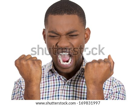 Closeup portrait of upset angry man in with both fists raised open mouth yelling, isolated on white background. Negative emotion facial expression feelings. Conflict problems and issues - stock photo