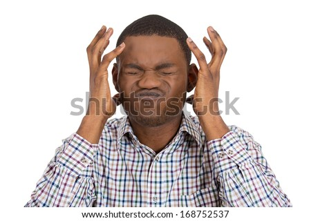 Closeup portrait of very stressed, depressed, overwhelmed, disappointed, gloomy young man, having a bad headache, isolated on white background. Negative human emotions, facial expressions, emotions - stock photo