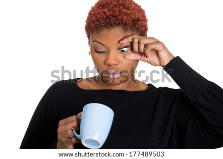 Closeup portrait of very tired falling asleep young woman, student holding cup of coffee struggling not to crash stay awake, keeping eyes opened, isolated on white background. Human face expression - stock photo