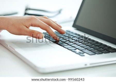 Closeup portrait of woman's hand typing on computer keyboard - stock photo