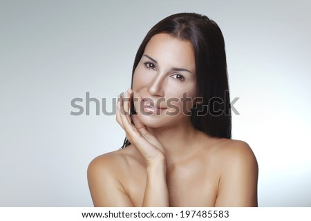 Closeup portrait of 30 years old young woman on light grey studio background - stock photo