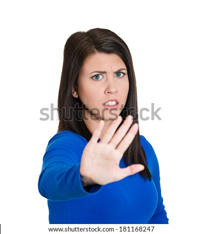 Closeup portrait of young annoyed woman with bad attitude, giving talk to hand gesture with palm outward, isolated on white background. Negative human emotion, facial expression feeling, body language - stock photo