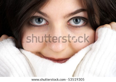 Closeup portrait of young attractive female with white sweater - stock photo