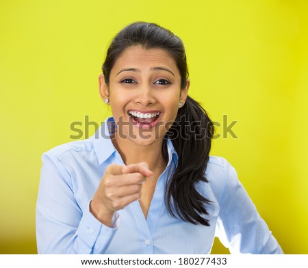 Closeup portrait of young, beautiful, excited, happy woman smiling, laughing, pointing finger towards you, camera gesture, isolated green yellow background. Positive human emotion, attitude, reactions - stock photo