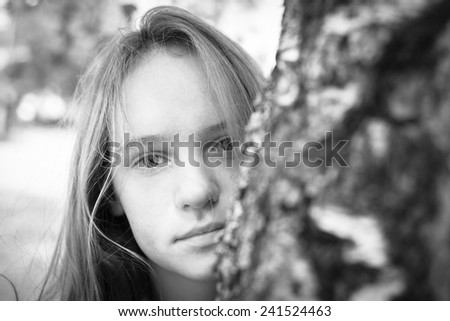 Closeup portrait of young beautiful girls outdoors. Black and white photography. - stock photo