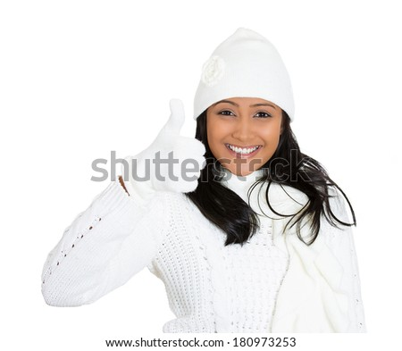 Closeup portrait of young beautiful pretty woman wearing winter gear attire sweater giving thumbs up, optimistic full of energy isolated on white background. Positive emotion facial expression feeling - stock photo