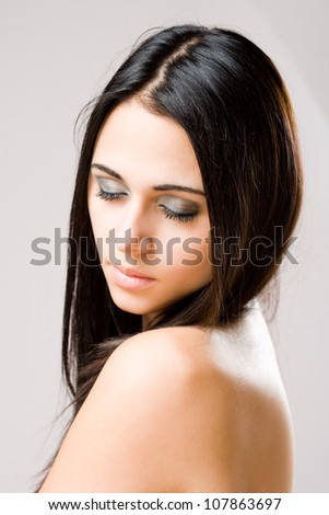 Closeup portrait of young brunette beauty in light makeup. - stock photo