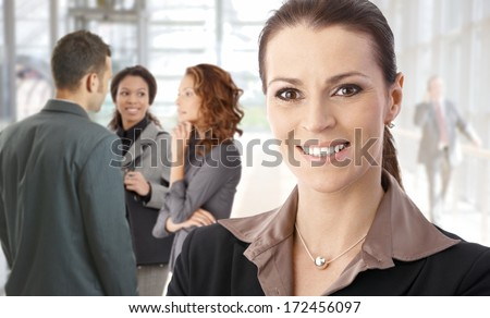 Closeup portrait of young businesswoman smiling happy on the street. - stock photo