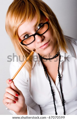 closeup portrait of young businesswoman with pencil - stock photo