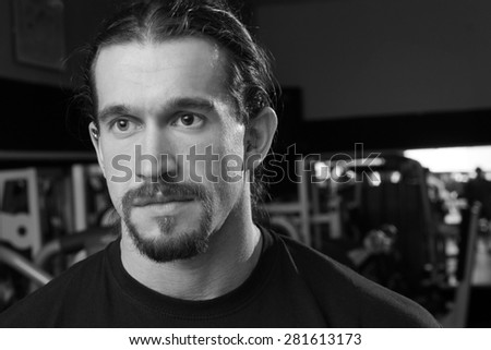 Closeup portrait of young Caucasian man in the gym. - stock photo